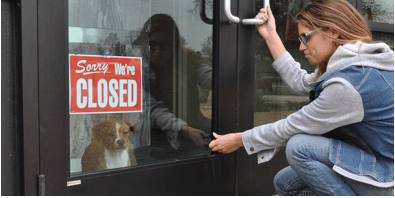A woman who can't get to her dog because the facility is closed.